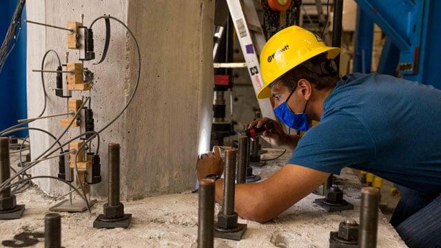 Kallan Hart working  in structures lab